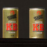 Two cans of KB Lager were displayed in tribute to Raudonikis.