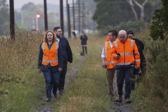 Transport Minister Melissa Horne and V/Line CEO James Pinder arrive at the scene.
