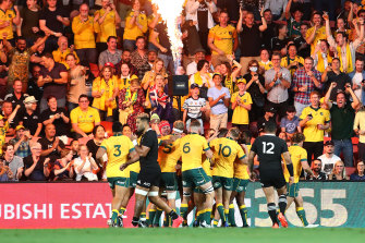 Red Bled redemption: The Wallabies celebrate in Brisbane.