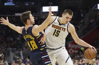 Matthew Dellavedova tries to get in the way of a Nikola Jokic drive.