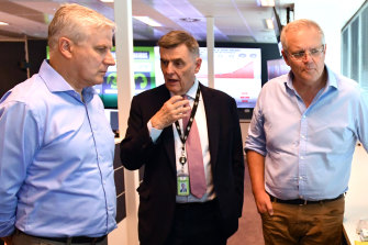 Chief Medical Officer Brendan Murphy gives Deputy Prime Minister Michael McCormack and Prime Minister Scott Morrison an update on coronavirus at the National Incident Room of the Department of Health in Canberra on Wednesday.
