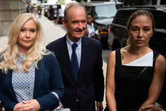 David Boies, representing several of Jeffrey Epstein's alleged victims, centre, arrives with Annie Farmer, right, and VirginiaGiuffre.