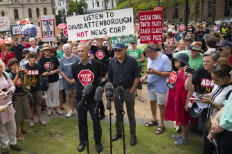Brown, flanked by businessman Geoffrey Cousins, addresses a rally in Brisbane to protest against the proposed Adani Carmichael coalmine.