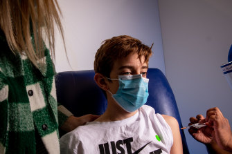 Lucas, 12, has his first vaccination at the Heidelberg Repatriation Hospital, Melbourne.  Britain's decision brings the UK into line with countries like Australia which will offer the Pfizer vaccine to the over 12s from Monday.