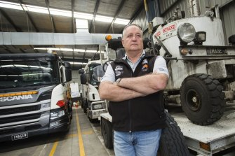 Linemarker Craig Riley is one of the business owners who is owed money after a builder on the Western Roads project went bust.