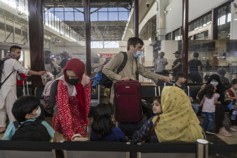 Passengers waiting to board a flight from Kabul's reopened international airport.
