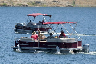 Members of the Ventura County Sheriff's Office are seen in the boats on Monday.