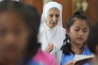 Sister Ana Rosa Sivori and students pray inside a church in Udon Thani, about 570 kilometres north-east of Bangkok, Thailand.