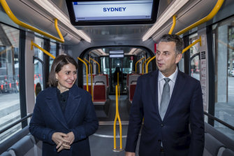 Premier Gladys Berejiklian and Transport Minister Andrew Constance inspect a tram parked at Town Hall.