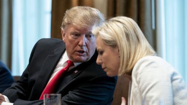 US President Donald Trump with former   secretary of homeland security Kirstjen Nielsen.