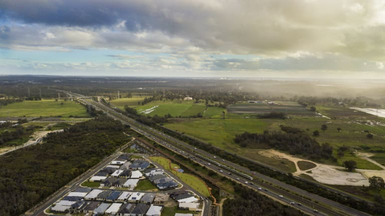 The City of Kwinana looking southwest from Wandi, with the Kwinana Freeway running south through the middle of the frame and the Kwinana industrial area in the distance. Under the framework the industrial area will extend from Rockingham in the south to the city of Cockburn in the north.