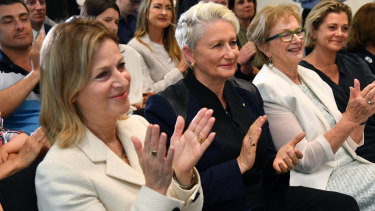 Things are getting personal on the campaign trail for Federal Member for Wentworth, Independent Kerryn Phelps,(centre), and her wife, Jackie Stricker-Phelps (left).