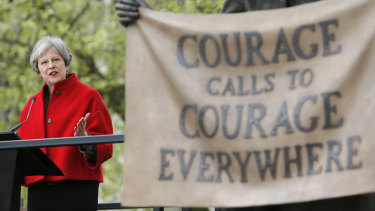 She may need courage: British Prime Minister Theresa May speaks after the unveiling of a statue of women's rights campaigner Millicent Fawcett in Parliament Square, London, last week.
