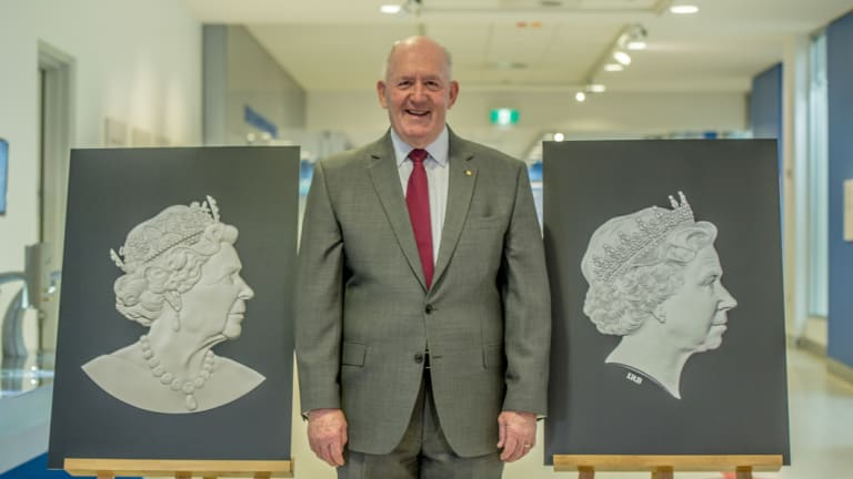 Governor-General Sir Peter Cosgrove with the old and new effigy of the Queen. The new portrait, left,  was unveiled in Canberra on Monday.
