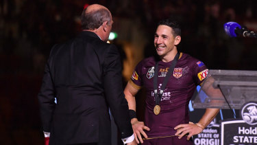 Controversial choice: Wally Lewis presents Billy Slater with the player-of-the-series medal.