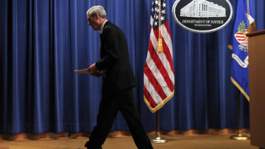 Job done: Special Counsel Robert Muller walks from the podium after speaking at the US Department of Justice on Wednesday.
