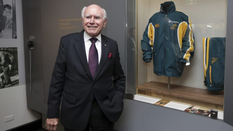 Former Prime Minister John Howard with one of his old tracksuits during the opening of the UNSW Howard Library at Old Parliament House in Canberra on Tuesday 4 December 2018.