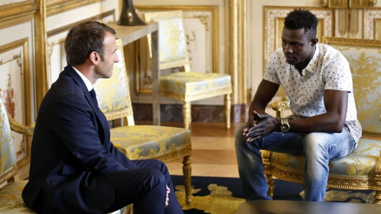 'Bravo': French President Emmanuel Macron meets with Mamoudou Gassama at the presidential Elysee Palace.
