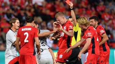 Insult to injury: Players clash after Stefan Mauk is injured and then given a red card.