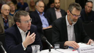 Defence officials Chris Birrer and Steve Grzeskowiak are grilled at a parliamentary inquiry into PFAS contamination in Williamtown, north of Newcastle.
