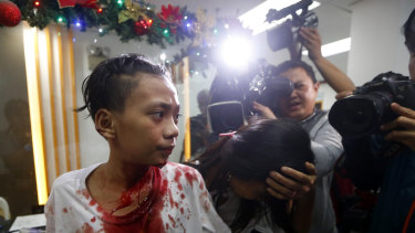 An injured reveller walks into a hospital after raucous new year celebrations in the Philippines.