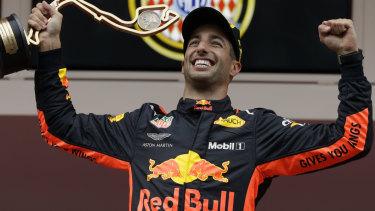 Daniel Ricciardo celebrates on the podium.