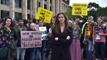 "21-year-old anti-euthanasia campaigner Izzy Lindsey, rallying on the steps of Parliament House, says she worries the laws will open ""dangerous doors""."
