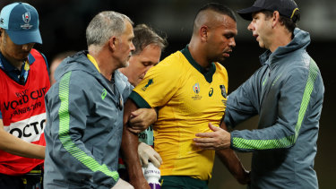 Kurtley Beale is helped off the field early in the Wallabies' clash with Georgia on Friday night.