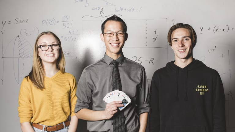 Eddie Woo (centre) made a special visit to a group of Hawker College students, including Diana Morton, 16 (left), and Hulieo Anderson, 17 (right).