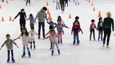 Closure on ice: children learn to skate at Macquarie Ice Rink.