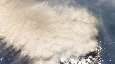 A satellite photo shows the moments following an eruption of La Soufriere volcano on Friday.