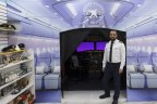Ahmed Abdelwahed outside the flight simulator he has constructed in his EzyMart store on Elizabeth Street.