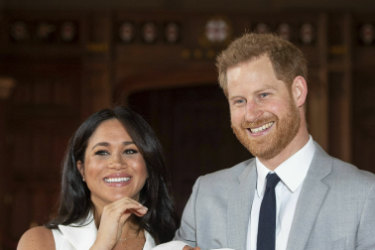 "Britain's Prince Harry and Meghan, Duchess of Sussex, during a photocall with their newborn son, in St George's Hall at Windsor Castle, Windsor, south England, Wednesday May 8, 2019. Baby Sussex was born Monday at 5:26 a.m. (0426 GMT; 12:26 a.m. EDT) at an as-yet-undisclosed location. An overjoyed Harry said he and Meghan are ""thinking"" about names."