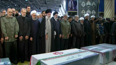 Ayatollah Ali Khamenei, fourth from left, leads a prayer over the coffins of General Qassem Soleimani and his comrades.
