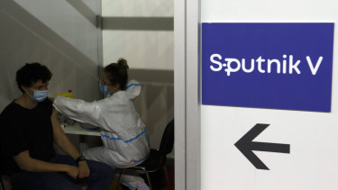 A man receives a COVID-19 vaccine at a vaccination centre in Belgrade, Serbia.