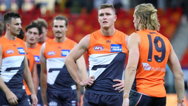 Giant flop: GWS players ponder their 61-point spanking.