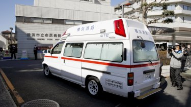 An ambulance carrying a passenger from the Diamond Princess cruise ship arrives at a hospital in Yokohama, near Tokyo.