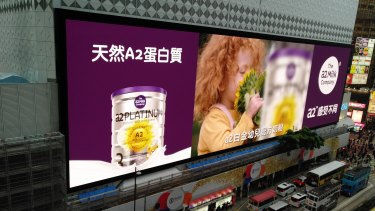 Billboards in Hong Kong advertising a2 infant formula. The company says it will double its marketing spend in China.