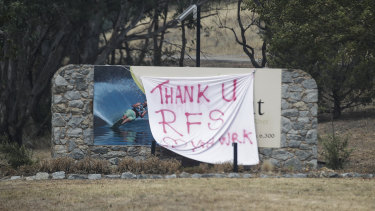 A sign thanking RFS firefighters on the road between Tumut and Batlow after bushfires impacted the Batlow region.