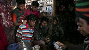 Rohingya refugees watch ICJ proceedings in a refugee camp in Cox's Bazar, Bangladesh.