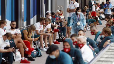 Poland's team wait for medical tests related to COVID-19 on their arrival for the Tokyo 2020 Olympics.