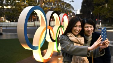 A selfie in front of the Tokyo Olympic rings near the new National Stadium in Tokyo.