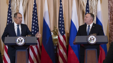 Russian Foreign Minister Sergei Lavrov speaks as US Secretary of State Mike Pompeo listens after their meeting at the State Department in Washington.