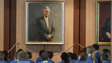 Students from Lake Joondalup Baptist College in Western Australia in front of former prime minister Bob Hawke's portrait during their tour of Parliament House this week.