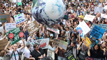 Thousands of school students attend the global climate strike rally at Town Hall in Sydney.