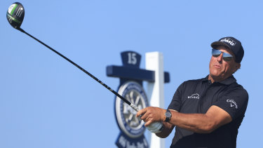 Phil Mickelson launches a drive on his way to the lead of the US PGA Championship.
