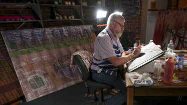 Artist and author the Reverend Glenn Loughrey at his studio in St Oswald's Anglican Church, Glen Iris.