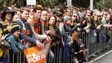 Spectators watch the 2019 AFL Grand Final Parade on September 27, 2019 in Melbourne, Australia.