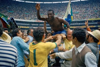 Brazil's Pele is hoisted on the shoulders of his teammates after Brazil won the 1970 World Cup final against Italy.