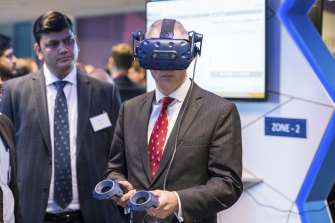 Minister for Communications, Cyber Safety and the Arts Paul Fletcher uses a VR headset at a 5G event earlier in the year.